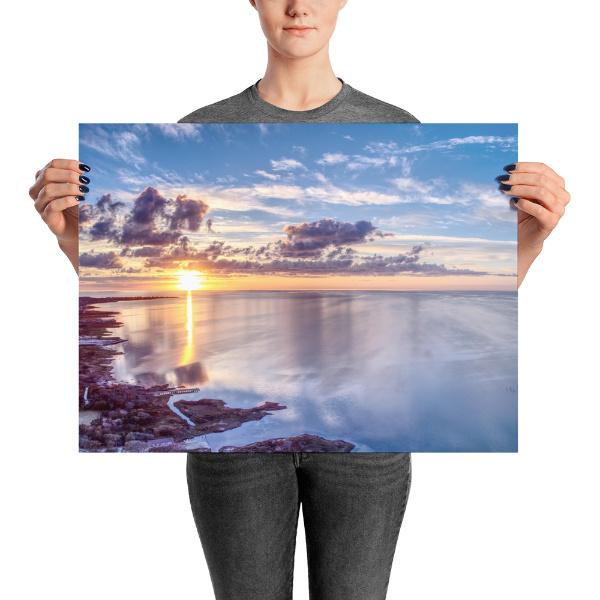 Woman holding 18x24 photo print of Buxton Sunset